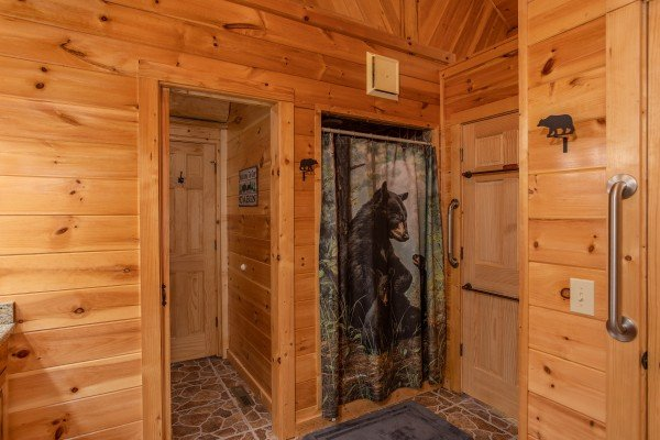 King bedroom en suite with walk in shower at Great View Lodge, a 5-bedroom cabin rental located in Pigeon Forge