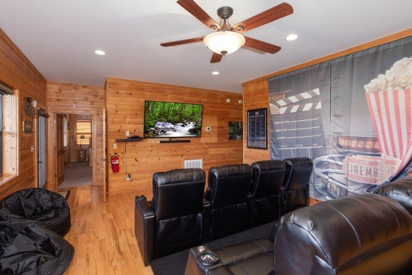 Theater room with bean bags and eight recliners at Great View Lodge, a 5-bedroom cabin rental located in Pigeon Forge