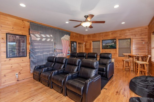 Eight reclining seats in the theater room at Great View Lodge, a 5-bedroom cabin rental located in Pigeon Forge
