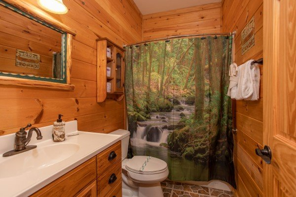 Bathroom with a tub and shower at Great View Lodge, a 5-bedroom cabin rental located in Pigeon Forge