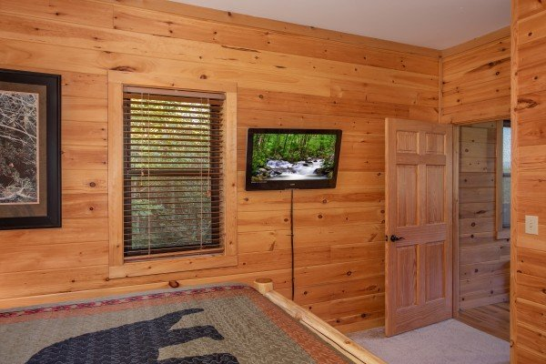 Wall mounted TV in a bedroom at Great View Lodge, a 5-bedroom cabin rental located in Pigeon Forge