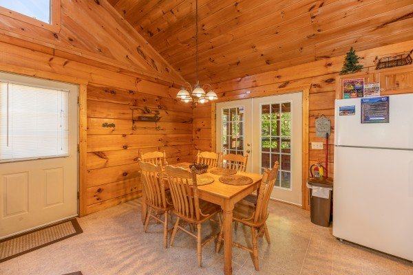 Dining room with seating for six off the kitchen at Eagle's Loft, a 2 bedroom cabin rental located in Pigeon Forge