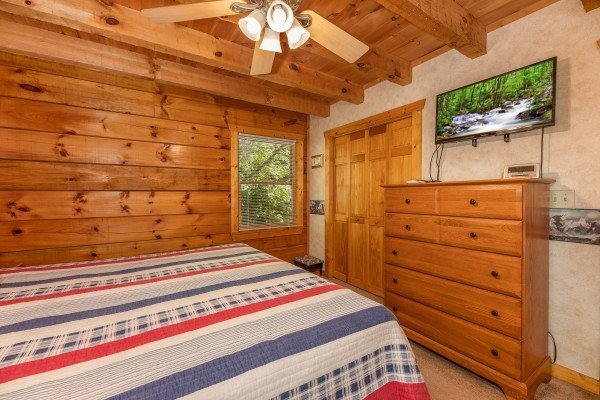 Bedroom with a dresser and TV at Eagle's Loft, a 2 bedroom cabin rental located in Pigeon Forge