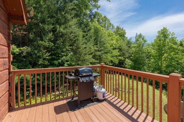 Gas grill on an open deck at Eagle's Loft, a 2 bedroom cabin rental located in Pigeon Forge