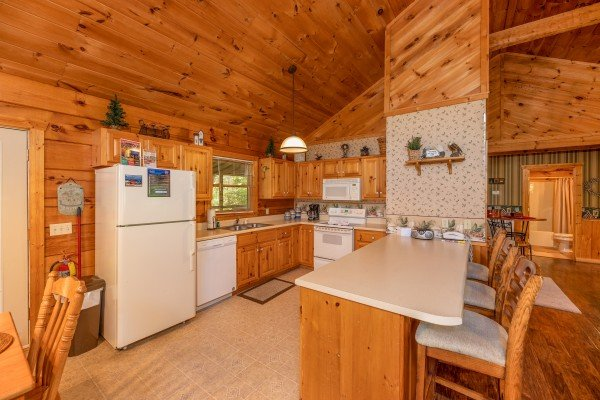 Kitchen with white appliances at Eagle's Loft, a 2 bedroom cabin rental located in Pigeon Forge