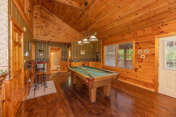 Pool table in the large living room at Eagle's Loft, a 2 bedroom cabin rental located in Pigeon Forge