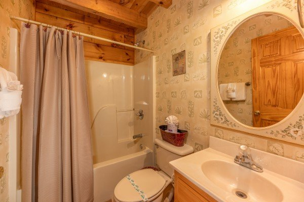 Bathroom with a tub and shower at Eagle's Loft, a 2 bedroom cabin rental located in Pigeon Forge