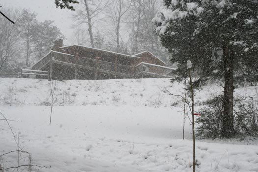Snow covers Eagle's Loft, a 2-bedroom cabin rental located in Pigeon Forge