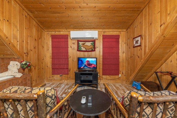 Seating area with TV at A Beary Nice Cabin, a 2 bedroom cabin rental located in Pigeon Forge