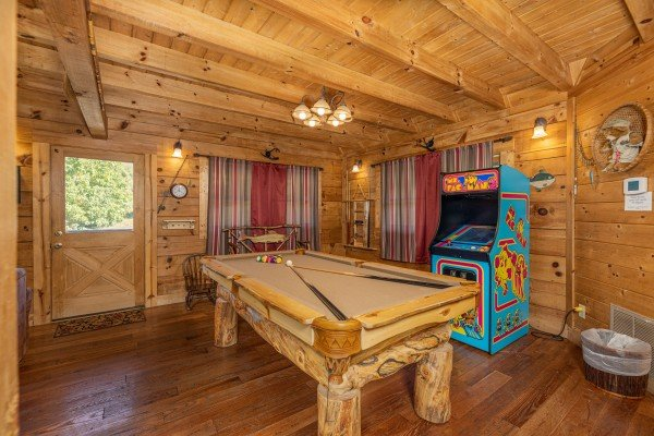 Pool table and arcade game at A Beary Nice Cabin, a 2 bedroom cabin rental located in Pigeon Forge