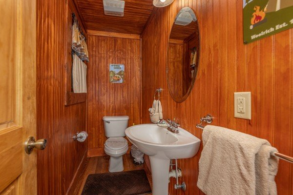 Half bath at A Beary Nice Cabin, a 2 bedroom cabin rental located in Pigeon Forge