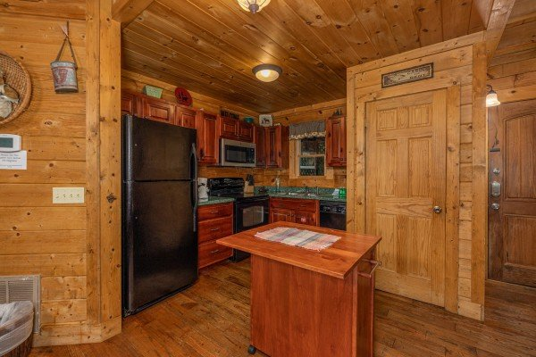 Kitchen with black appliances at A Beary Nice Cabin, a 2 bedroom cabin rental located in Pigeon Forge
