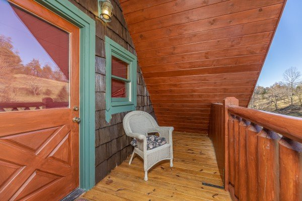 Wicker chair on a deck at A Beary Nice Cabin, a 2 bedroom cabin rental located in Pigeon Forge
