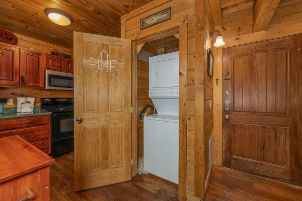 Stacked washer and dryer at A Beary Nice Cabin, a 2 bedroom cabin rental located in Pigeon Forge