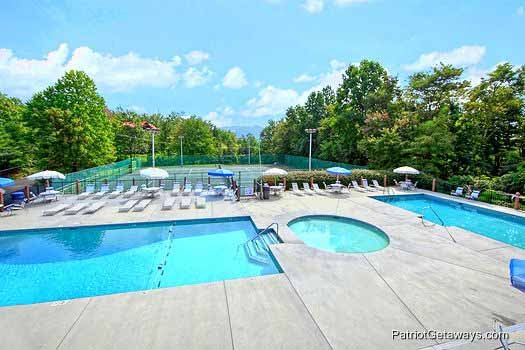 Outdoor pool at Chalet Village for guests at Terrace Garden Manor, a 13 bedroom cabin rental located in Gatlinburg
