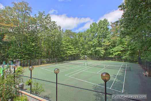 Chalet Village tennis courts for guests at Terrace Garden Manor, a 13 bedroom cabin rental located in Gatlinburg