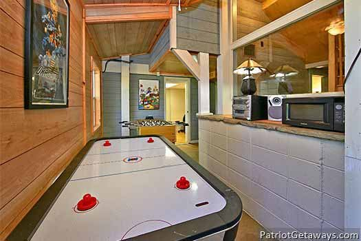 Air hockey table and CD player in the game area at Terrace Garden Manor, a 13 bedroom cabin rental located in Gatlinburg
