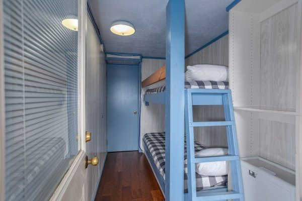 Twin bunks in a small bedroom at Terrace Garden Manor, a 13 bedroom cabin rental located in Gatlinburg