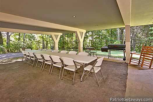 Carport set up for dining at Terrace Garden Manor, a 13 bedroom cabin rental located in Gatlinburg