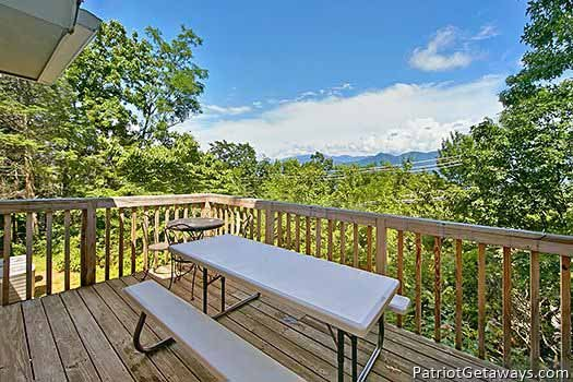 Deck picnic table at Terrace Garden Manor, a 13 bedroom cabin rental located in Gatlinburg