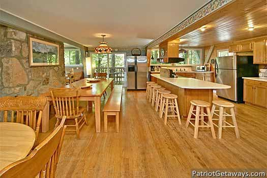 Dining room seating for large groups at Terrace Garden Manor, a 13 bedroom cabin rental located in Gatlinburg