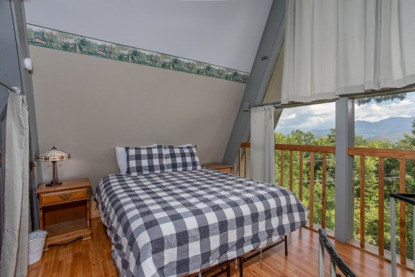 Bedroom on the third floor with mountain views at Terrace Garden Manor, a 13 bedroom cabin rental located in Gatlinburg