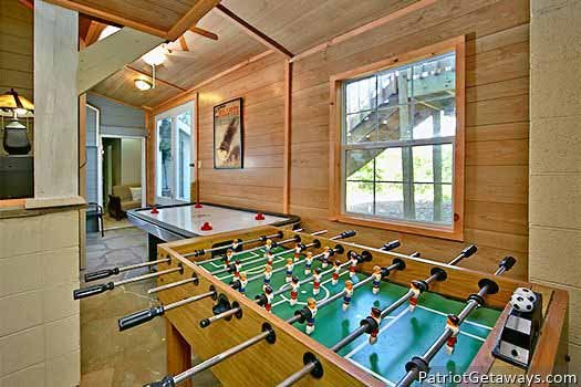 Foosball and air hockey in the game area at Terrace Garden Manor, a 13 bedroom cabin rental located in Gatlinburg