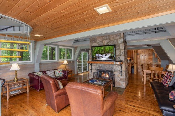 Fireplace and seating in the main living room at Terrace Garden Manor, a 13 bedroom cabin rental located in Gatlinburg