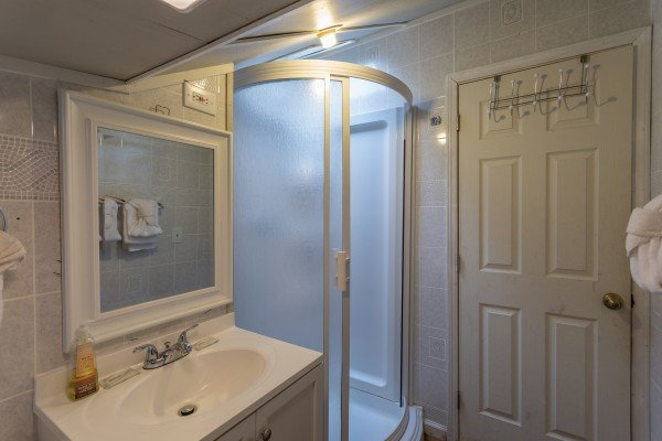 Bathroom with a shower stall at Terrace Garden Manor, a 13 bedroom cabin rental located in Gatlinburg