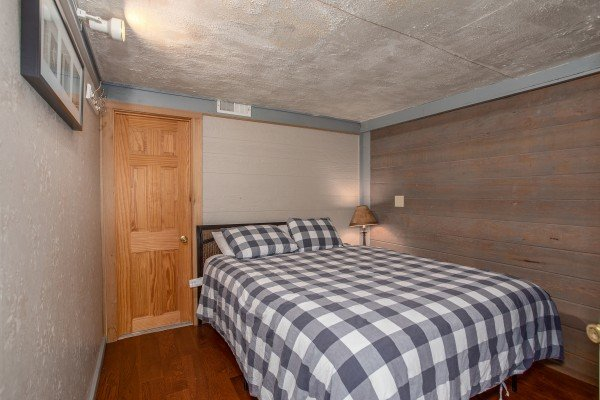 Bedroom with a bed and nightstand at Terrace Garden Manor, a 13 bedroom cabin rental located in Gatlinburg