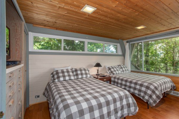 Bedroom with two full beds at Terrace Garden Manor, a 13 bedroom cabin rental located in Gatlinburg