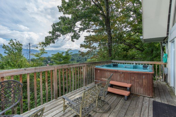 Hot tub on a deck at Terrace Garden Manor, a 13 bedroom cabin rental located in Gatlinburg