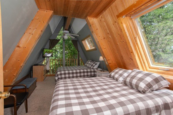 Bedroom with two queen beds in a loft space at Terrace Garden Manor, a 13 bedroom cabin rental located in Gatlinburg