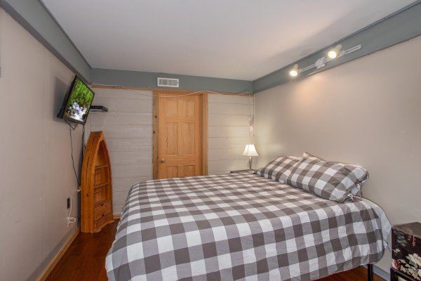 Bedroom with two full beds and a TV at Terrace Garden Manor, a 13 bedroom cabin rental located in Gatlinburg