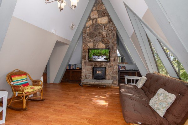 Fireplace and seating in the loft at Terrace Garden Manor, a 13 bedroom cabin rental located in Gatlinburg