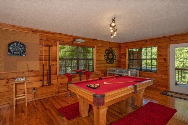 Pool table and dart board at Hello Dolly, a 1 bedroom cabin rental located in Pigeon Forge