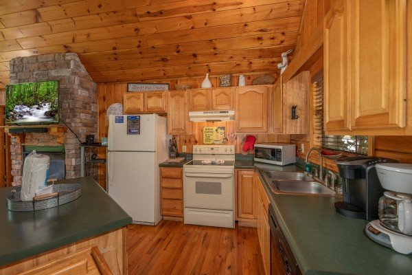 Kitchen at Hello Dolly, a 1 bedroom cabin rental located in Pigeon Forge