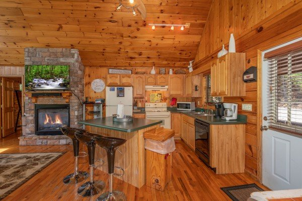 Kitchen and breakfast bar at Hello Dolly, a 1 bedroom cabin rental located in Pigeon Forge
