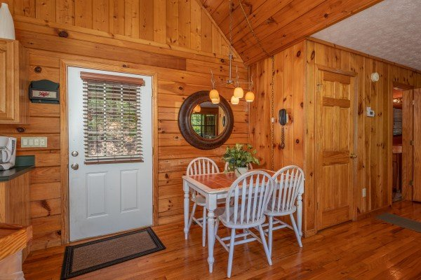 Kitchen table at Hello Dolly, a 1 bedroom cabin rental located in Pigeon Forge