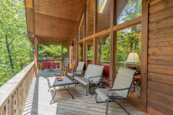 Covered main deck with chairs at Hello Dolly, a 1 bedroom cabin rental located in Pigeon Forge