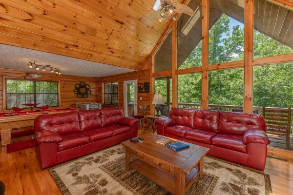 Sofas and large windows in the living room at Hello Dolly, a 1 bedroom cabin rental located in Pigeon Forge