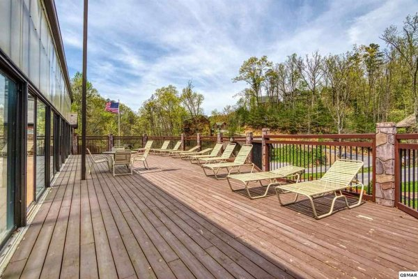 Resort pool deck at Hidden Springs Resort at Hello Dolly, a 1 bedroom cabin rental located in Pigeon Forge