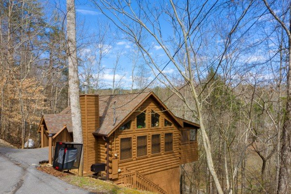 Parking and driveway with cabin in the background at Fowl Play, a 1 bedroom cabin rental located in Pigeon Forge