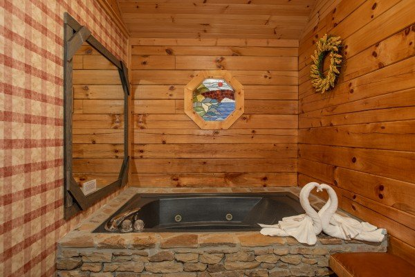 Jacuzzi tub in the bedroom at Fowl Play, a 1 bedroom cabin rental located in Pigeon Forge