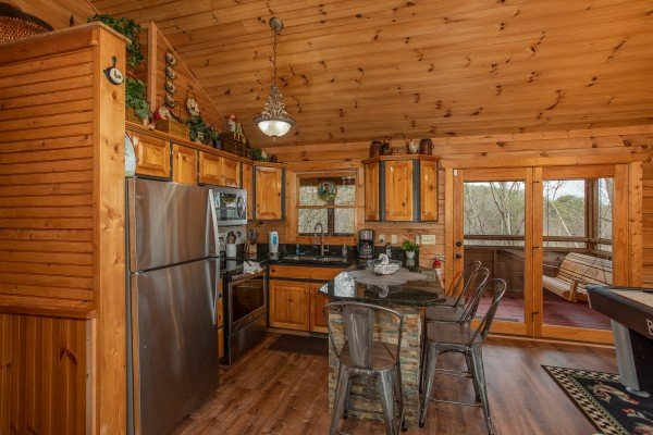 Kitchen with breakfast bar seating for four at Fowl Play, a 1 bedroom cabin rental located in Pigeon Forge