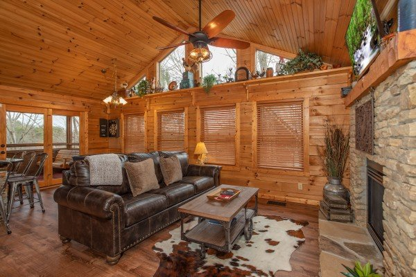 Sofa in the living room at Fowl Play, a 1 bedroom cabin rental located in Pigeon Forge