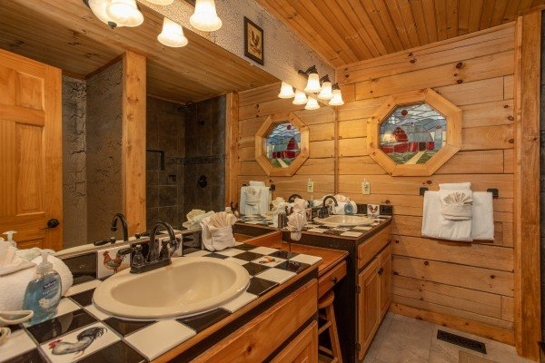 Bathroom with his and hers sinks at Fowl Play, a 1 bedroom cabin rental located in Pigeon Forge