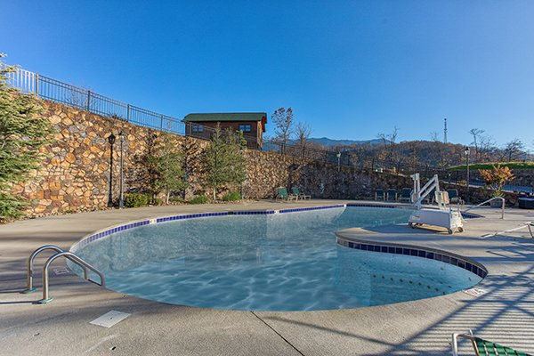 Pool at Gatlinburg Falls Resort is accessible for guests of Heaven's Dew, a 1-bedroom cabin rental located in Gatlinburg