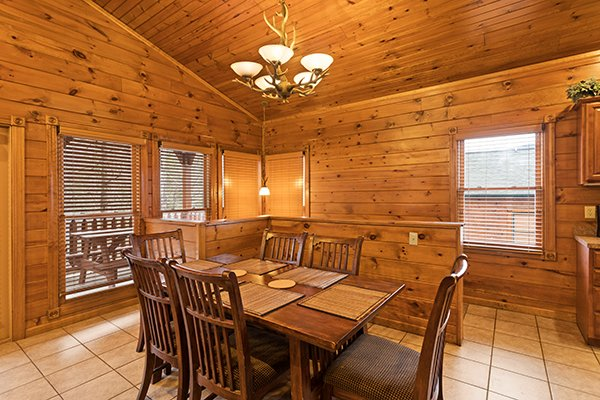 Dining table for six at Heaven's Dew, a 1-bedroom cabin rental located in Gatlinburg