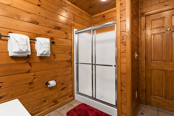Bathroom with a walk in shower at Heaven's Dew, a 1-bedroom cabin rental located in Gatlinburg